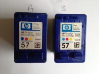 An original HP inkjet cartridge and a cloned version
