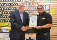 Cartridge World's Alan Cridge present store owner Amit Patel with the Gold Standard certificate. Credit: Newham Recorder