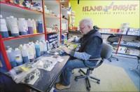 Merton Moore refilling an inkjet cartridge in-store (Credit: Troy Fleece/Leader-Post)