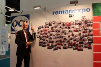 OCP's Carsten Edelmeier in front of the company's photo wall