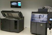 HP Inc's MultiJet Fusion 3D printer and post-process station (Credit: TCT Magazine)