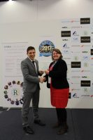 wta's CEO Carsten Weser presented with 'Remanufacturer of the Year' by The Recycler's Stefanie Unland